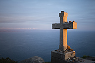 Spain, Galicia, Finisterre, Cape Finisterre, Stone cross, end of pilgrims' path Camino de Santiago - RAEF000605