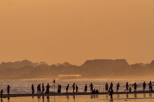Indonesia, Bali, people on Kuta beach at sunset - KNT000153