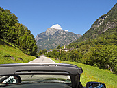 Switzerland, Ticino, Valle Maggia, convertible car on country road - LAF001520