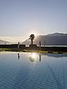 Switzerland, Ticino, Lago Maggiore, swimming pool at lakeside - LAF001535