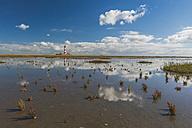 Germany, Schleswig-Holstein, North Sea Coast, View of Westerheversand Lighthouse, tideland - KEBF000262