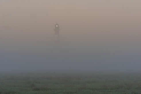 Germany, Schleswig-Holstein, View of Westerheversand Lighthouse in fog - KEBF000277