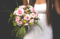Bride holding her bouquet, close-up - GEMF000459