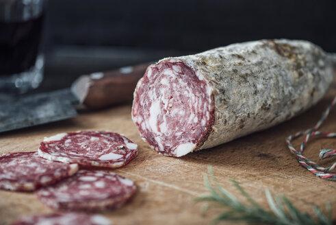 Sliced salami on cutting board - IPF000266