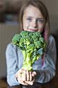 Girl holding broccoli - SARF002285