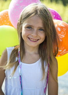 Portrait of smiling little girl with balloons - SARF002288