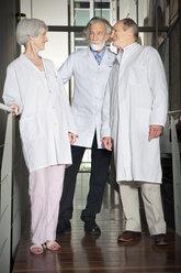 Three senior wearing laboratory coats at university - RMAF000163