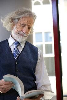 Senior professor holding book - RMAF000169