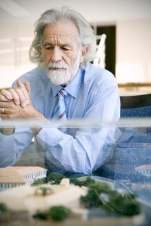 Senior man studying architectural model - RMAF000181