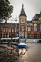 Netherlands, Amsterdam, Tramway in front of central station - EVG002489