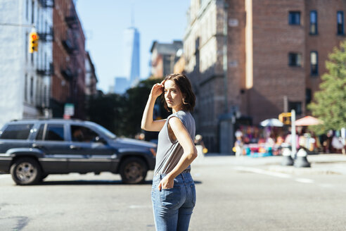 USA, New York City, woman standing on a street - GIOF000395