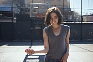 USA, New York, Manhattan, smiling young woman on a playground - GIOF000413