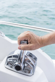 France, Bormes-les-Mimosas, man's hand on control stick of a motorboat - JUN000449