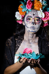 Woman dressed as La Calavera Catrina, Traditional Mexican female skeleton figure symbolizing death - ABAF001946