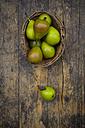Wickerbasket of organic Bonne de Longueval on dark wood - LVF004136