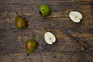 Whole and sliced Bonne de Longueval with kitchen knife on dark wood - LVF004139