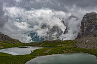 Italy, Alto Adige, Dolomites, view to Piani lakes and Paternkofel mountains on a cloudy day - LOMF000067