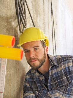 Foreman checking construction work with pocket rule - LAF001549
