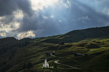 Italy, South Tyrol, Small church on Gardena pass in a stormy day - LOMF000087