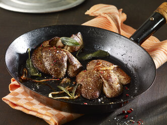 Fried rabbit liver with sage and pink pepper in pan - SRSF000605