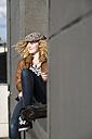 Smiling teenage girl relaxing outdoors - UUF005941