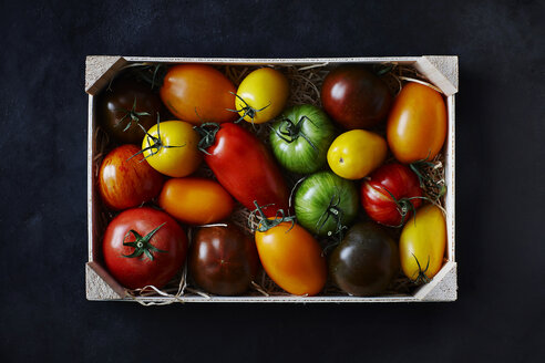 Different tomatoes in wooden box - KSWF001656