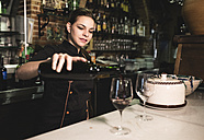 Waitress serving red wine in a bar - JASF000247