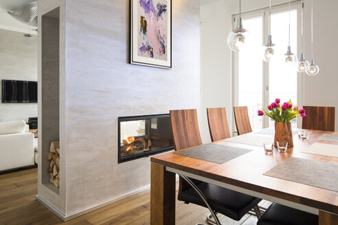 Interior of modern flat, Dining area and fireplace - FKF001515