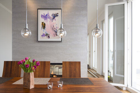 Interior of modern flat, Dining area and fireplace - FKF001521