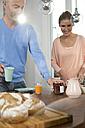 Couple having breakfast at home - FKF001536