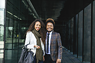 Portrait of two smiling young business people outdoors - EBSF001106