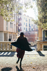 Italy, Verona, vital young woman in the city - GIOF000531