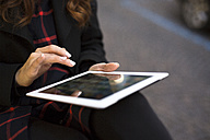 Close-up of woman using digital tablet outdoors - GIOF000537