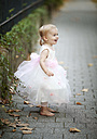 Happy blond little girl wearing tulle dress - NIF000058