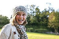 Portrait of laughing girl in a park - MGOF001063