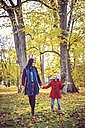 Mother and daughter walking in autumnal park - VTF000482