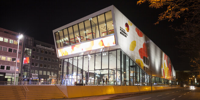 Germany, Dortmund, lighted German Football Museum at night - WI002930