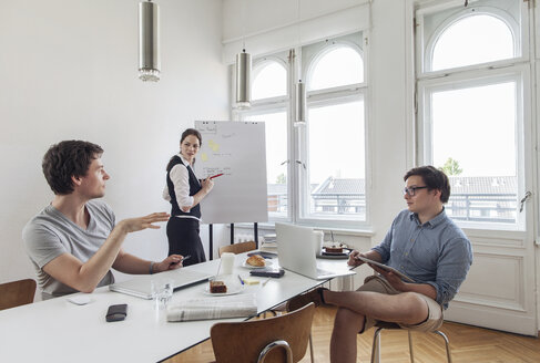 Three creative business people having a meeting in a modern office - JUBF000061