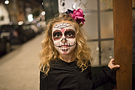 Blond little girl with sugar skull makeup at Halloween - RAEF000665
