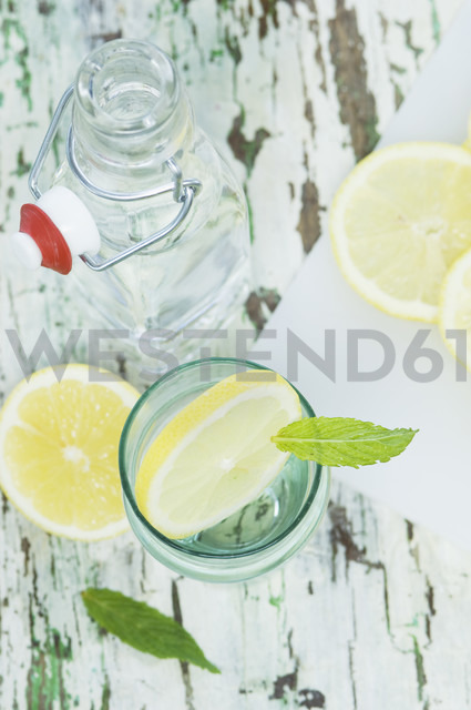 Slice of lemon and mint in water glass, bottle - ASF005762