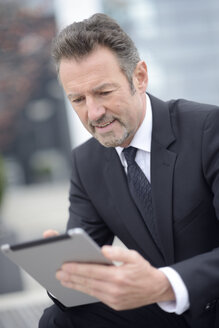 Young businessman using digital tablet - GUFF000169
