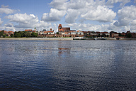 Poland, Torun, view to city skyline with Vistula River in the foreground - ABOF000048