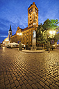 Poland, Torun, town hall at the old town marketplace by evening twilight - ABOF000051