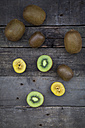 Green and golden kiwis on wood - LVF004176