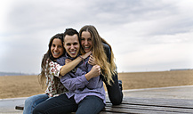 Group picture of three friends having fun together - MGOF001073