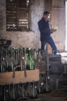 Germany, Burghausen, old wooden beer crates with empty beer bottles at Raitenhaslach Abbey - HAMF000104