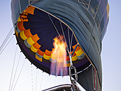 Namibia, Kuala Wilderness Reserve, Air balloon being filled with heated air - AM004452