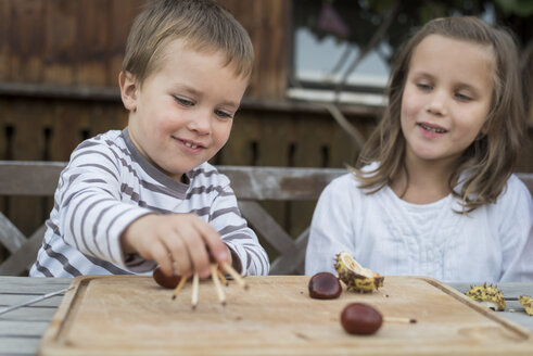 Two children tinkering with chestnuts - PAF001487