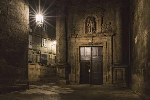 Spain, Santiago de Compostela, facade of San Paio de Antares Monastery by night - RAEF000674