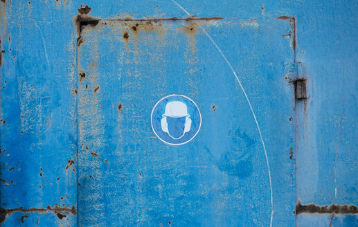Pictogram on blue metal door, noise protection - DASF000035